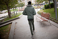 An African migrant heads to the bus station, to try to cross the border. Irun (Basque Country). October 20, 2018. A group of volunteers has created a host network to serve migrants and inform about the public services they are entitled to and the ways to cross the border. This group of volunteers is avoiding a serious humanitarian problem Irun, the Basque municipality on the border with Hendaye. As the number of migrants arriving on the coasts of southern Spain incresead, more and more migrants are heading north to the border city of Irun. French authorities have reacted by conducting random checks as far as the city of Bordeaux, more than 200 kilometers north of the border. Migrants who are caught are then deported back to Irun. (Gari Garaialde / Bostok Photo).