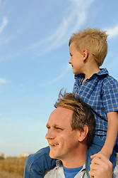 Father carrying his son on shoulders, Bavaria, Germany