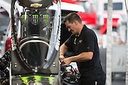 April 22-24, 2016: NHRA 4 Wide Nationals, Charlotte NC. Brittany Force's Top Fuel car is worked on by a mechanic.
