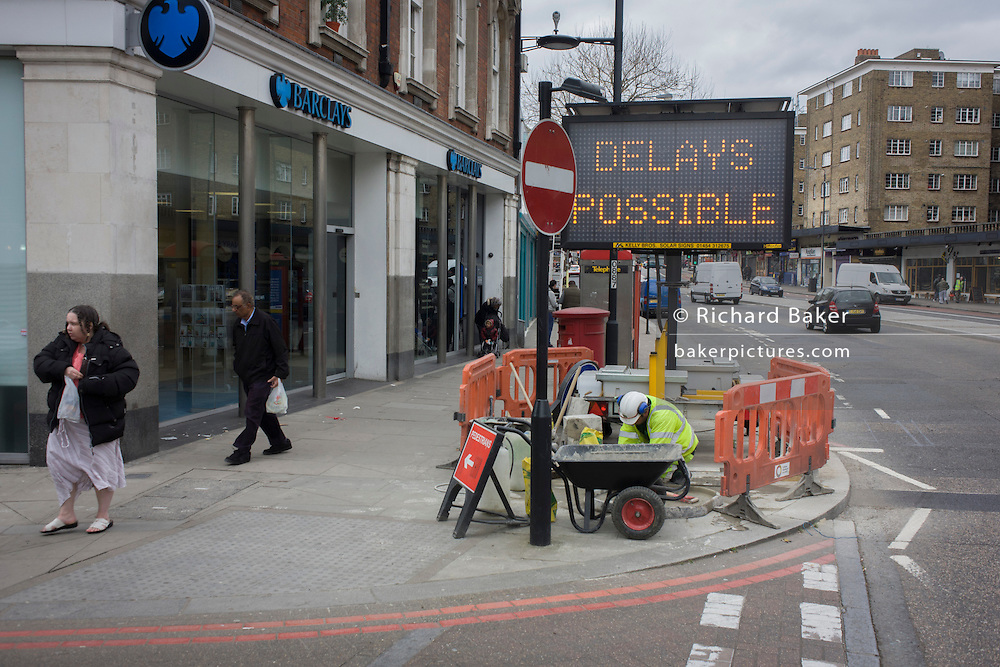 Delays Possible written on a matrix board during roadworks in a south London high road.