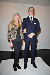 NOELLE RENO with a statue of Prince William at a private view of 'Engagement' an exhibition of new works by Jennifer Rubell held at the Stephen Friedman Gallery, 25-28 Old Burlington Street, London on 7th February 2011.