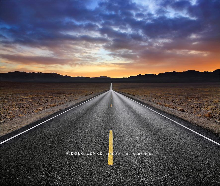A Two Lane Blacktop Highway Running Through Death Valley National Park, California, USA
