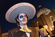 A young man dressed as a Mexican cowboy skeleton during the Day of the Dead festival in the Plaza Civica October 28, 2016 in San Miguel de Allende, Guanajuato, Mexico. The week-long celebration is a time when Mexicans welcome the dead back to earth for a visit and celebrate life.