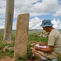 Smithsonian archaeologist Dr. William Fitzhugh studies 2700+ year-old, bronze age Deer Stones and khirigsur burial mounds Ulaan Tolgoi near Lake Erkhel & Muren, Mongolia.