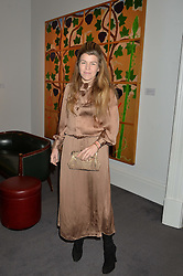 AMBER NUTTALL at a private view of Made in Britain featuring contents from The Ivy sold to benefit Child Bereavement UK held at Sotheby's, 34-35 New Bond Street, London on 23rd March 2015.
