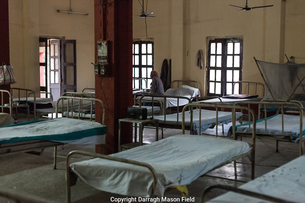 A man with leprosy sits in the men's ward of Avadhoot Bhagwan Ram Kustha Sewa Ashram leprosy hospital.