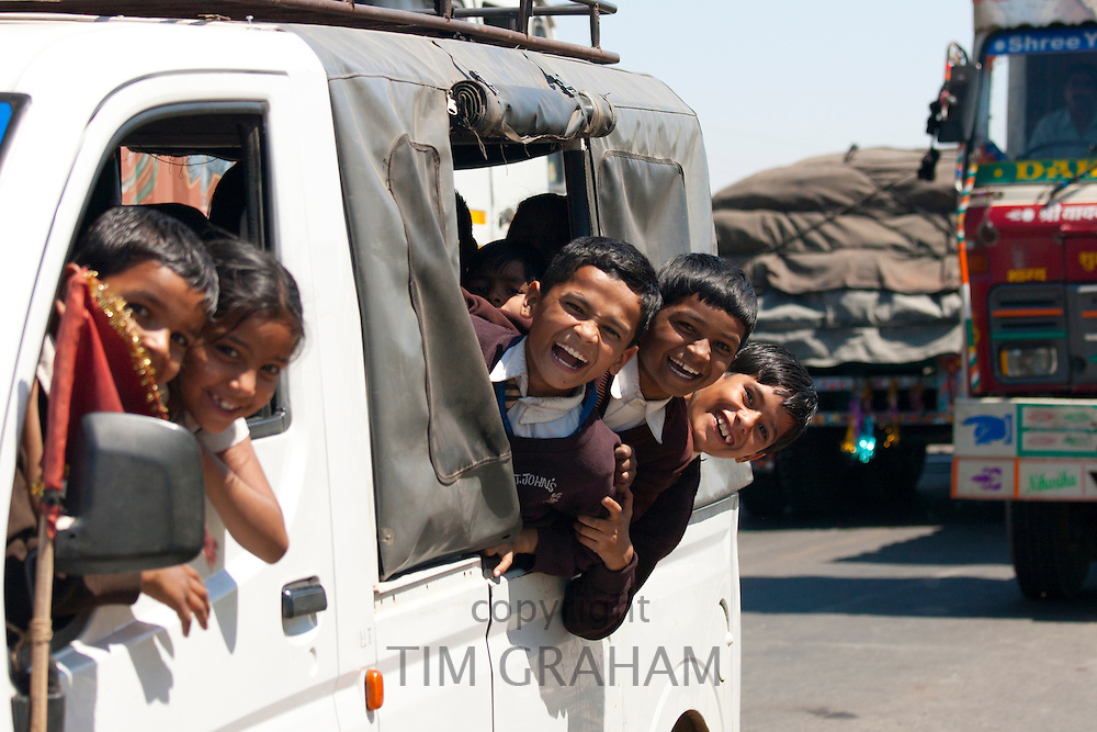 Schoolchildren on Delhi to Mumbai National Highway 8 at Jaipur, Rajasthan, Northern India