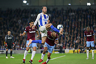Brighton and Hove Albion striker Glenn Murray (17) battles in the air with West Ham United defender Pablo Zabaleta (5) during the Premier League match between Brighton and Hove Albion and West Ham United at the American Express Community Stadium, Brighton and Hove, England on 5 October 2018.