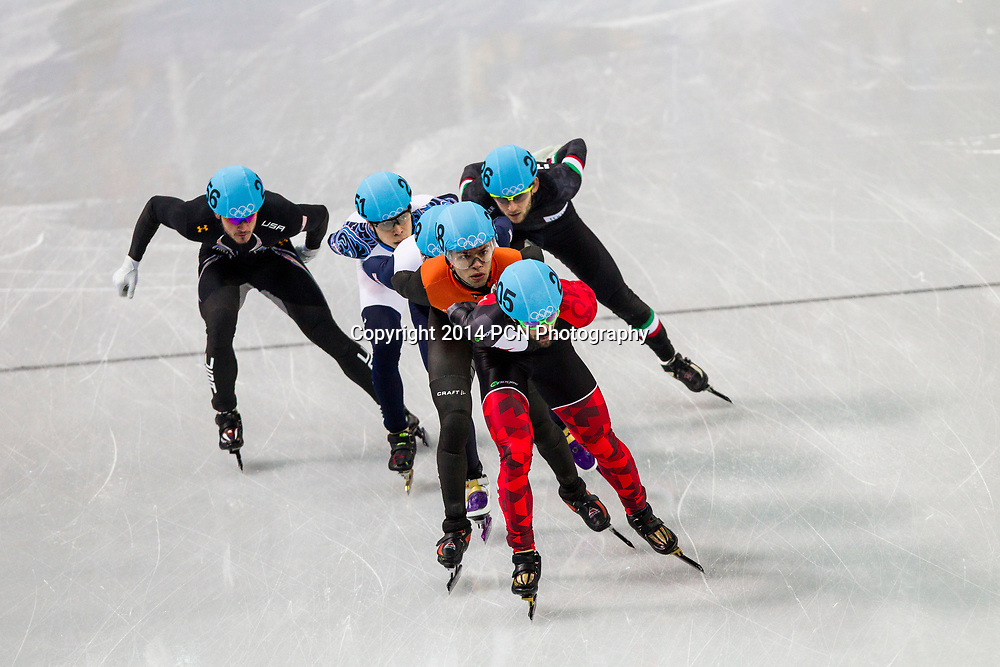 Charles Hamlin (CAN) Sjinkie Knegt (NED) competing in the Men's Short Track 1500m semifinals at the  Olympic Winter Games, Sochi 2014