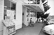 """Y-680604-A13.  """"Lowrie's Food Mart""""  Lowrie's grocery store, it had frozen food lockers for rent. Store on first floor, the second floor was one big room. School children had big Halloween parties there. Entrance to top floor was at rear of building. On the right side of the building they showed  movies in the park during the summertime. Aurora, Oregon. June 4, 1968"""