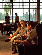 Men enjoy drinks together inside of a luxurious Country Club & Golf Resort