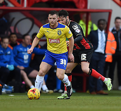Huddersfield Town's Harry Bunn makes a break from Bournemouth's Adam Smith - Photo mandatory by-line: Paul Knight/JMP - Mobile: 07966 386802 - 14/02/2015 - SPORT - Football - Bournemouth - Goldsands Stadium - AFC Bournemouth v Huddersfield Town - Sky Bet Championship