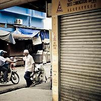 Muslim man selling water in downtown Kuala Lumpur
