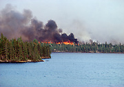 Wildland fire consuming boreal forest adjoining Mack Lake near Sioux Narrows, Ontario, Canada.