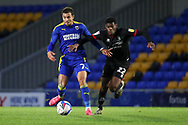 AFC Wimbledon midfielder Cheye Alexander (7) battles for possession with Lincoln City defender Timothy Eyoma (22) during the EFL Sky Bet League 1 match between AFC Wimbledon and Lincoln City at Plough Lane, London, United Kingdom on 2 January 2021.