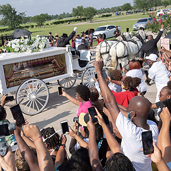 A carriage containing bthe body of GELRGE FLOYD approaches Pearland Cemetery for final burial in Tuesday, June 9, 2020.
