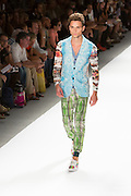 Men's print pants with elastic cuffed hems, V-neck long-sleeved top and aqua print vest. By Custo Barcelona at the Spring 2013 Fashion Week show in New York.