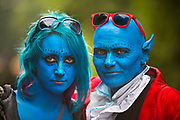 A couple in Avatar costume with blue face paint in the Glastonbury Festival 2016, United Kingdom. Glastonbury Festival is the largest greenfield festival in the world, and is now attended by around 175,000 people. Its a five-day music festival that takes place near Pilton, Somerset. In addition to contemporary music, the festival hosts dance, comedy, theatre, circus, cabaret, and other arts. Held at Worthy Farm in Pilton, leading pop and rock artists have headlined, alongside thousands of others appearing on smaller stages and performance areas.