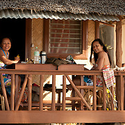 Girls in beach hut, Palawan, Philippines