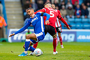 Gillingham FC forward Mikael Mandron (9) and Lincoln City defender Jason Shackell  (5) during the EFL Sky Bet League 1 match between Gillingham and Lincoln City at the MEMS Priestfield Stadium, Gillingham, England on 16 November 2019.