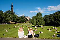 Summer hot weather brings many people into Princes Street Gardens in Edinburgh, Scotland, United Kingdom