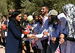 Duchess of Sussex speaks to students during their visit to the local Secondary School, Lycee Qualifiant Grand Atlas, where they met with students and teachers in Asni Town, Atlas Mountains on the second day of their tour of Morocco.