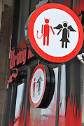 Devil and angel road sign. Photographed in Budapest, Hungary