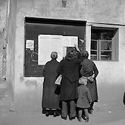 German townspeople get the first view of their orders upon the arrival of the American forces. April 1945