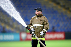A fireman waters the pitch ahead of the UEFA Euro 2020 Qualifying, Group I match at the Astana Arena.