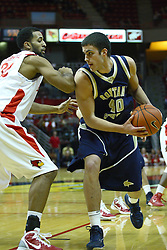 04 December 2010: Jackie Carmichael works to block out Jeff Budinich during an NCAA basketball game between the Montana State Bobcats and the Illinois State Redbirds at Redbird Arena in Normal Illinois.