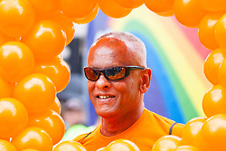 London, June 28th 2014. A man is surrounded by balloons as Pride London parade proceeds through the city's streets.
