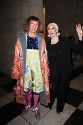Left to right, GRAYSON PERRY and CARMEN DELL'OREFICE at the London College of Fashion Show held at the Victoria & Albert Museum, Cromwell Road, London on 28th January 2010.