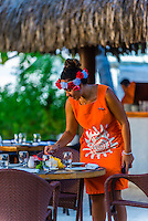 Waitresses setting tables at the Tere Nui Restaurant, Four Seasons Resort Bora Bora, Motu Tehotu, Bora Bora, French Polynesia.