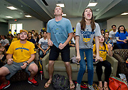 UCI students Matt Levin, Tim Schlueter, Liberty Pugh and Kimberly Vo, from left, react as they watch their University of California, Irvine basketball team play in the NCAA playoffs against the University of Louisville.