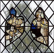 Medieval stained glass fragments window Holy Trinity church, Blythburgh, Suffolk, England, UK