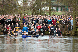 © London News Pictures. 05/03/2014. Ashbourne, UK. DAY TWO as  the Up'Ards and the Down'Ards, fight for the ball during the second day of the Royal Shrovetide Football match in Ashbourne, Derbyshire. For two days, over Shrove Tuesday and Ash Wednesday, hundreds of participants battle it out in a 'no rules' game dating back to the 17th Century where the aim is to get a ball into one of two goals that are positioned three miles apart at either end of Ashboune. Photo credit: Ben Cawthra/LNP