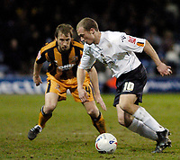 Photo: Leigh Quinnell.<br /> Luton Town v Hull City. Coca Cola Championship. 13/03/2007. Hulls David Livermore keeps an eye on Lutons Warren Feeney.