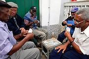 Old men spend the day playing cards  or going to the few bars open in Nova Sintra.