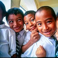 Children of Tibetan refugees attend a school in Kathmandu, Nepal, 1996.