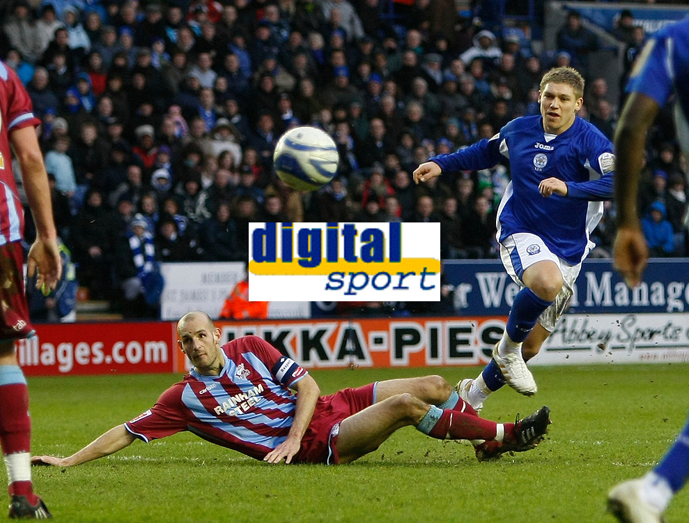 Photo: Steve Bond/Richard Lane Photography. Leicester City v Scunthorpe United. Coca Cola Championship. 13/02/2010. Martyn Waghorn (R) shoots as Rob Jones (L) tries to block