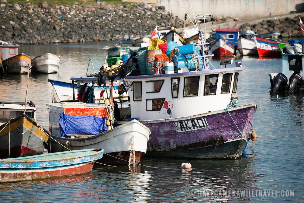Small wooden fishing boats on the waterfront of Panama City, Panama, on Panama Bay.