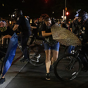 CHARLOTTE, NC - August 23:  A group of protestors, organized by Charlotte Uprising, clash with Charlotte-Mecklenburg police for a third night in a row as they march through uptown Charlotte near the site of the 2020 Republican National Convention in uptown Charlotte on August 23, 2020. The group, organized by Charlotte Uprising is protesting the existence of the convention in Charlotte, the policies of the Trump administration and the the abolishment of police and prisons. Delegates are holding private meetings inside the convention center ahead of the official start of the paired down convention on August 24th. (Photo by Logan Cyrus for AFP)