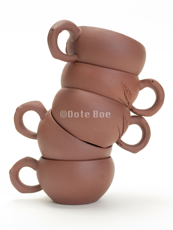 off balance stacked ceramic Chinese tea cups