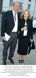LORD & LADY WEINBERG at a wedding in Suffolk in London on 20th September 2003.PMT 286