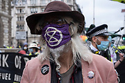 XR protesters at Extinction Rebellion demonstration on 3rd September 2020 in London, United Kingdom. With government resitting after summer recess, the climate action group has organised two weeks of events, protest and disruption across the capital. Extinction Rebellion is a climate change group started in 2018 and has gained a huge following of people committed to peaceful protests. These protests are highlighting that the government is not doing enough to avoid catastrophic climate change and to demand the government take radical action to save the planet.