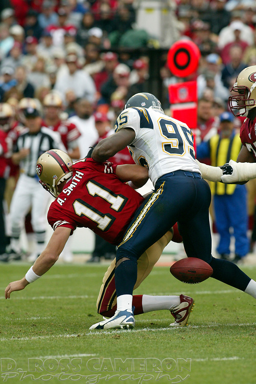 San Diego Chargers linebacker Shaun Phillips (95) strips the ball from San Francisco 49ers quarterback Alex Smith (11) during the second quarter of an NFL football game, Sunday, Oct. 15, 2006 at Candlestick Park in San Francisco. Offensive lineman Kwame Harris recovered for the 49ers. The Chargers won, 48-19. (D. Ross Cameron/The Oakland Tribune)