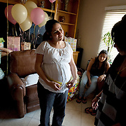 Alma Stauth, in white, at her baby shower. Alma is an undocumented immigrant who was brought here as a toddler and is facing deportation and separation from her family. Please contact Todd Bigelow directly with your licensing requests.