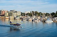 Seaplane taxis through harbor,  Victoria, Vancouver island, British Columbia, Canada