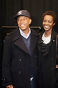 """7 January-NY, NY - l to r Russell Simmons and Guest at The Notorious premiere held at AMC Lincoln Square on January 7, 2009 in New York City. Photo Credit: Terrence Jennings/Sipa Press..Notorious charts the remarkable rise of Christopher """" The Notorious B.i.G """"-who in just a few short years, shot from the tough streets of Brooklyn to the heights of hip-hop legend."""
