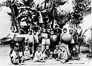 Children with locally made baskets posed under a palm tree, Saigon South Vietnam, c1900. Saigon  was the capital and commercial centre of French colonialism in French Indo-China.